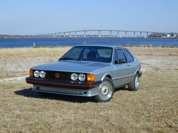 Brian's 1981s VW Scirocco sitting on the beach at his house